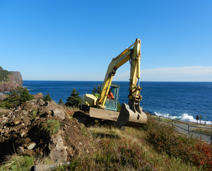 Backhoe by the water